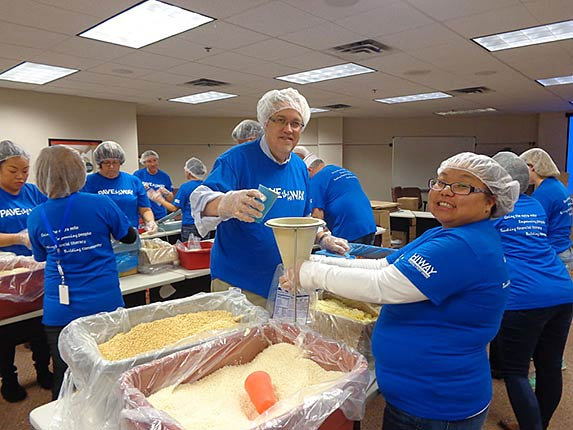 Hiway associates packing meals for Food for Kids