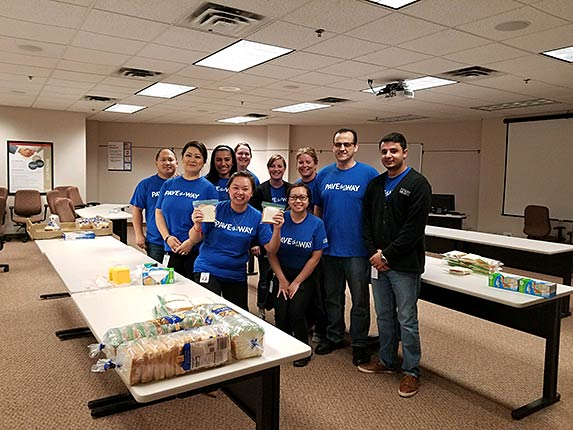 Hiway associates making sandwiches for Love One Another